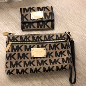 Michael Kors wristlet and marching wallet.